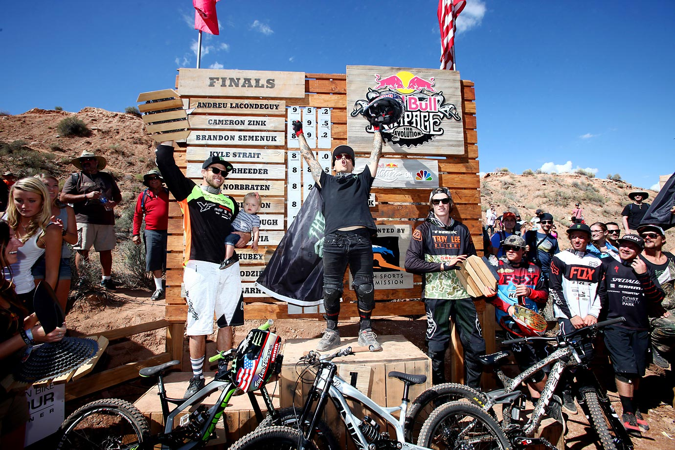 Cameron Zink, Andreu Lacondeguy, and Brandon Semenuk celebrate on the podium after the Red Bull Rampage.