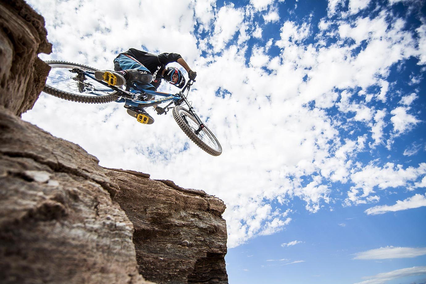 Ryan Howard of the U.S. drops onto the top ridge of his course line during qualifications for Red Bull Rampage freeride event in Virgin, Utah.