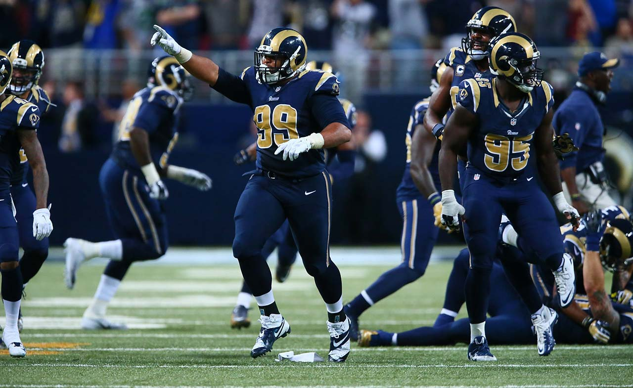 The St. Louis Rams celebrate their overtime victory over Seattle.