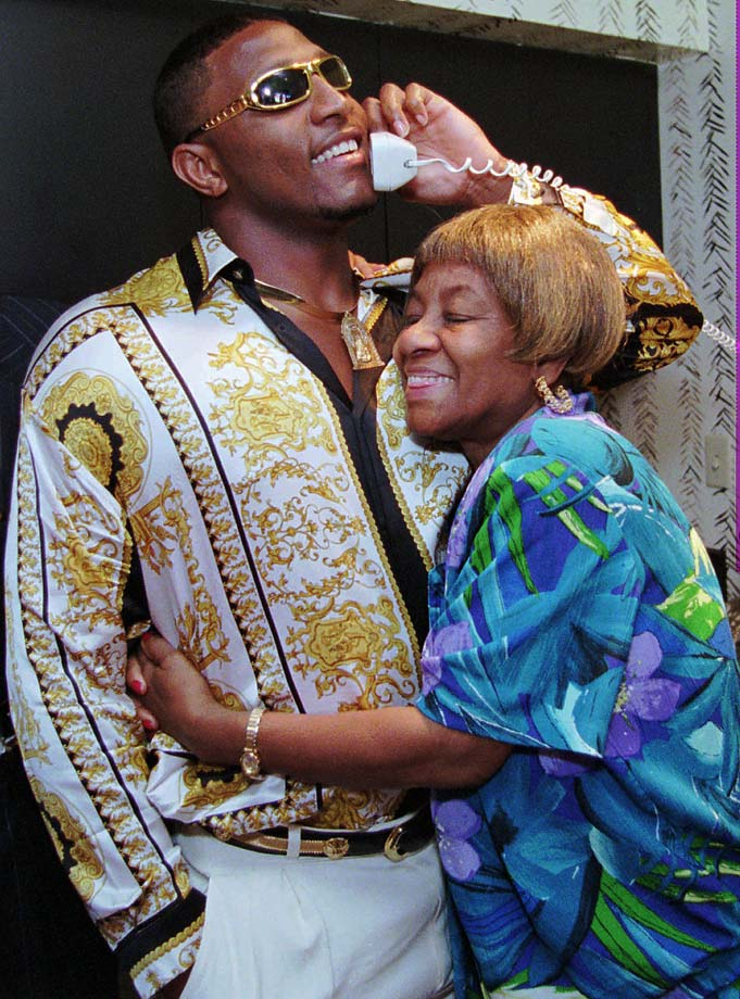 Ray Lewis is hugged by his grandmother Elease while speaking with the Baltimore Ravens after being taken in the first round of the 1996 draft.