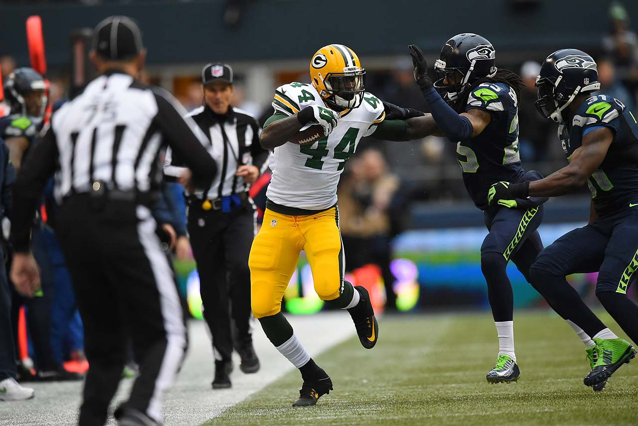 Richard Sherman injured his left arm while tackling James Starks on this play. He insists he'll play in the Super Bowl.