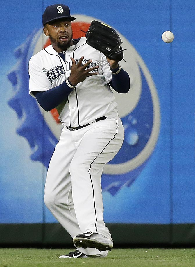 Seattle Mariners left fielder Rickie Weeks misses a catch against the Boston Red Sox.