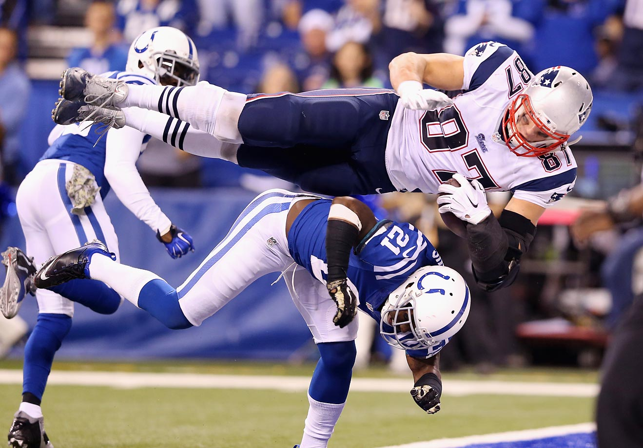 New England Patriots tight end Rob Gronkowski scores a touchdown against Vontae Davis of the Indianapolis Colts. The Patriots defeated the Colts 42-20.