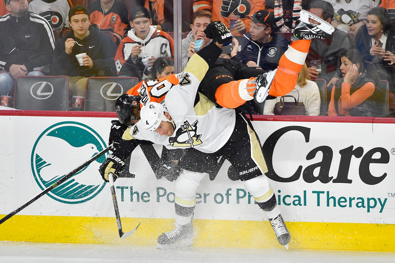 Pittsburgh Penguins defenseman Rob Scuderi body checks Philadelphia Flyers right wing Jakub Voracek.