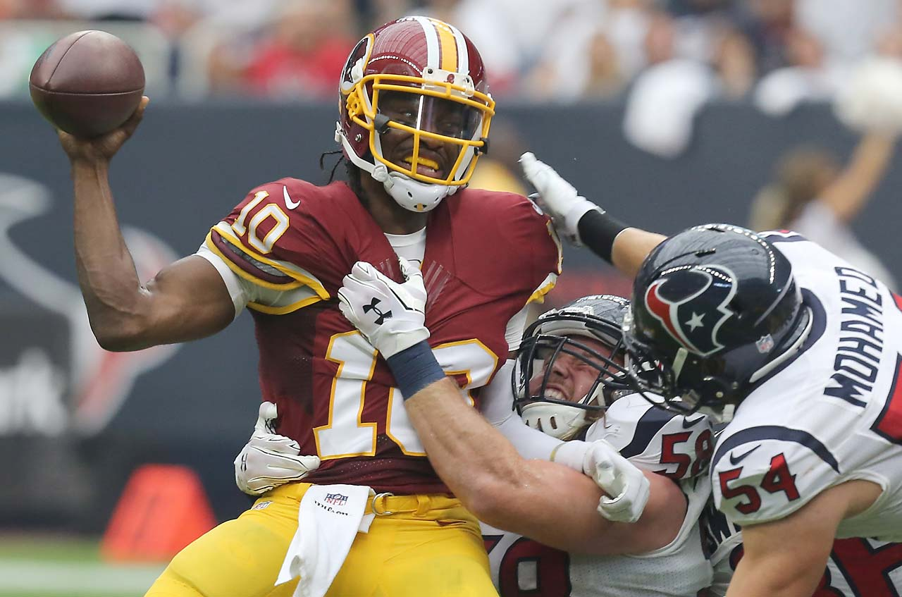 Washington Redskins quarterback Robert Griffin III is sacked by Houston Texans linebacker Brooks Reed (58) and linebacker Mike Mohamed .