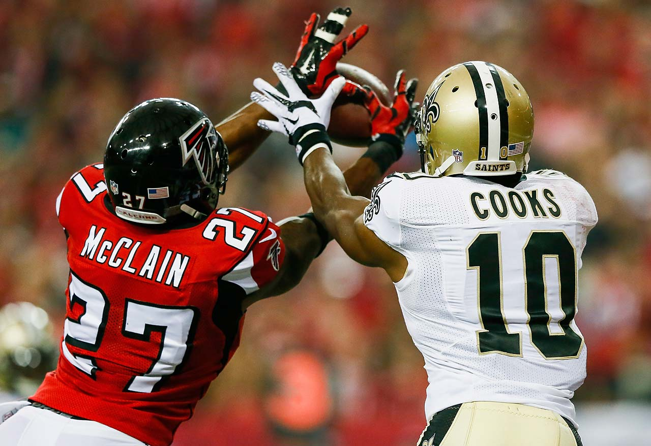 Robert McClain of the Atlanta Falcons intercepts a touchdown pass intended for Brandin Cooks of the New Orleans Saints.