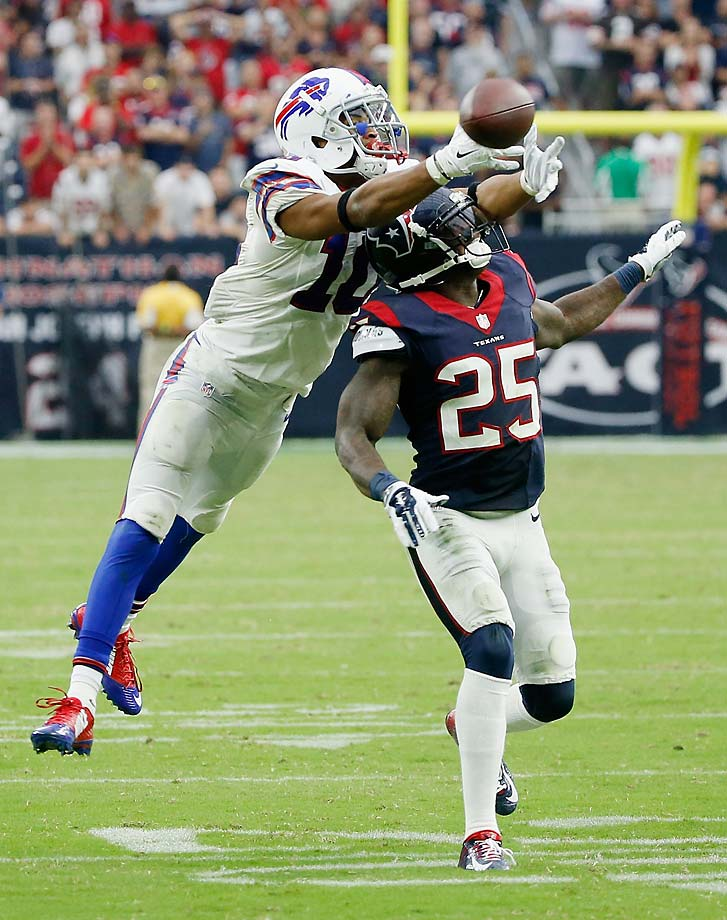 Robert Woods of the Buffalo Bills battles for the ball with Kareem Jackson of the Houston Texans.