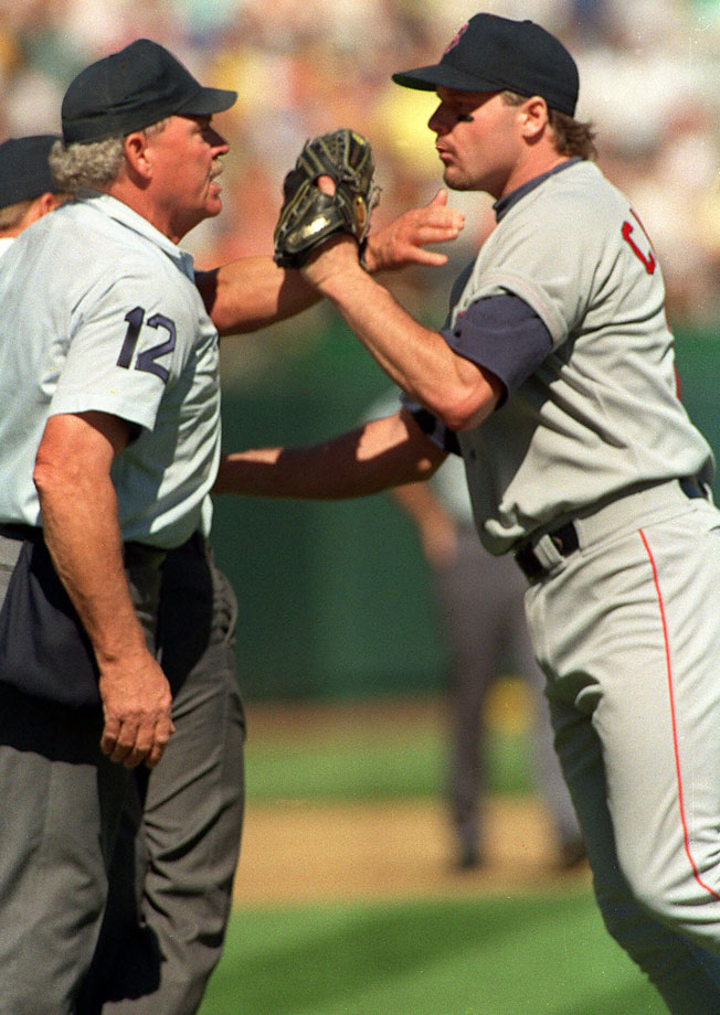 The Boston Red Sox pitcher received a five-game suspension and $10,000 fine for pushing umpire Terry Cooney during Game 4 of the 1990 ALCS against Oakland. The punishment was served the following season.