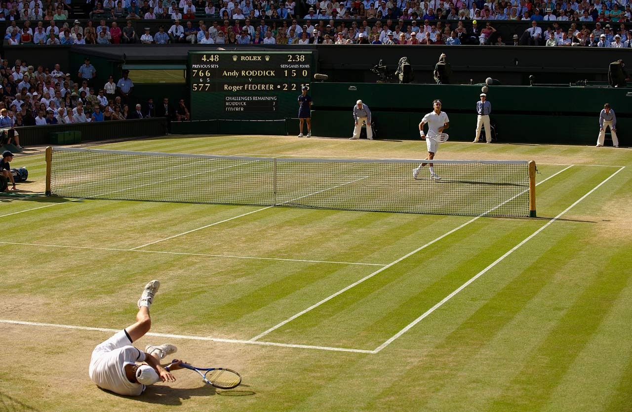 Federer moved ahead of Pete Sampras for most Grand Slam titles with his sixth victory at Wimbledon, which unfolded without injured defending champion Rafael Nadal. Federer outlasted Andy Roddick in a marathon match that went to 16-14 in the fifth set. Federer served 50 aces and overcame the resilient American 5-7, 7-6 (6), 7-6 (5), 3-6, 16-14. The 30 games in the fifth set established a record for the most games played in any set in a Wimbledon singles final.