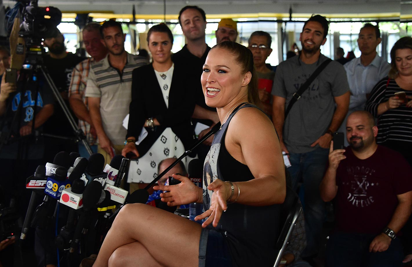 Ronda Rousey responds to questions during media day in Glendale, Calif., ahead of her showdown with Holly Holm.