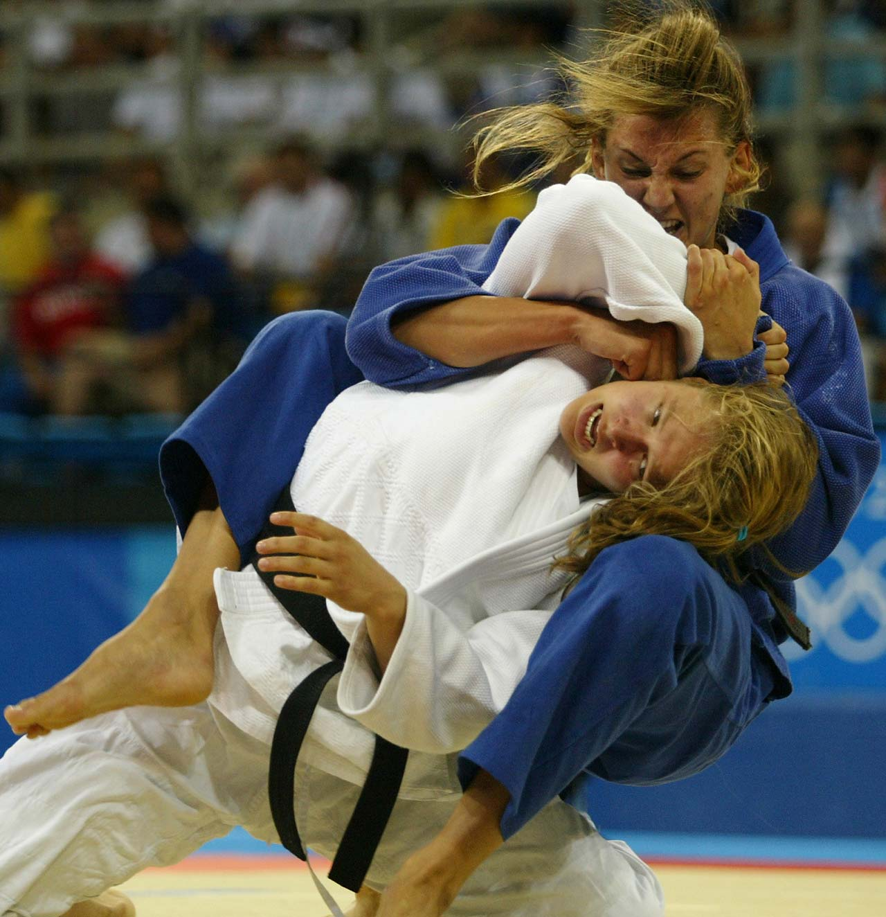 Claudia Heill from Austria fights Ronda Rousey during the Judo half-middle weight (-63kg)  event at the 2004 Olympic Games in Athens.