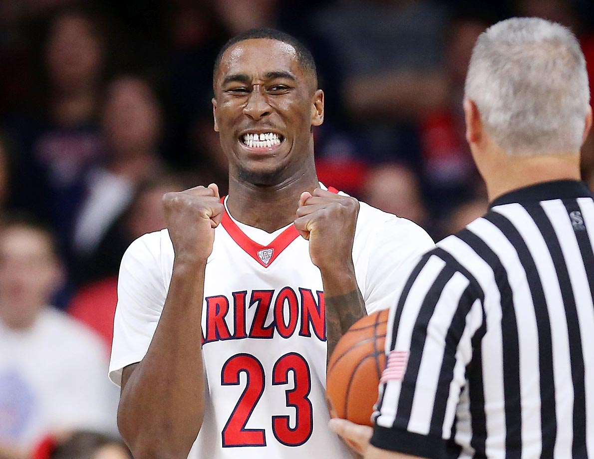 Arizona forward Rondae Hollis-Jefferson  jokes around with official Deron White.