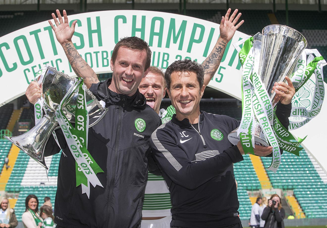 Leigh Griffiths of the Scottish Premiership club Celtic photobombs manager Ronny Deila and assistant John Collins.