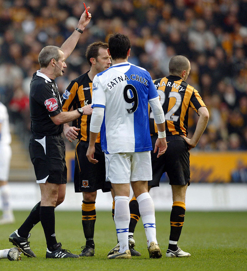 "No, the red card is not for Blackburn Rovers striker Roque Santa Cruz wearing a jersey with ""SATNA"" during a game against Hull City on March 1, 2009."