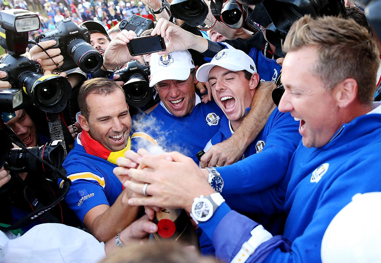 Sergio Garcia, Lee Westwood, Rory McIlroy and Ian Poulter of Europe celebrate their Ryder Cup win.