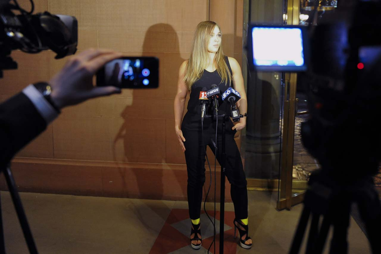 Ronda Rousey talks with reporters after meeting with New York Gov. Andrew Cuomo and state leaders urging them to join the 49 other states in legalizing mixed martial arts.