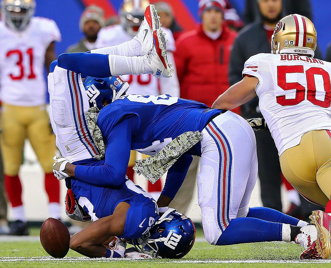 Giants receiver Rueben Randle lands after making a catch and collides with teammate Larry Donnell in the process. Randle wasn't charged with a fumble on the play.