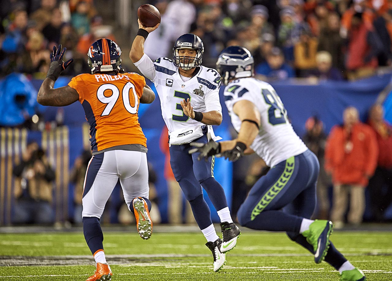Wilson was relegated to the third round of the 2012 draft because teams didn't know how well a 5-10 1/2-inch quarterback would do in the modern NFL, but Seahawks GM John Schneider saw greatness in him, and the Seahawks promoted him over free agent acquisition Matt Flynn in time for his first NFL game. In three years, Wilson has never played in a game where his team hasn't held a lead, has comparable stats to Tom Brady in Brady's first three seasons, and is almost impossible to beat at home -- just ask the Green Bay Packers.