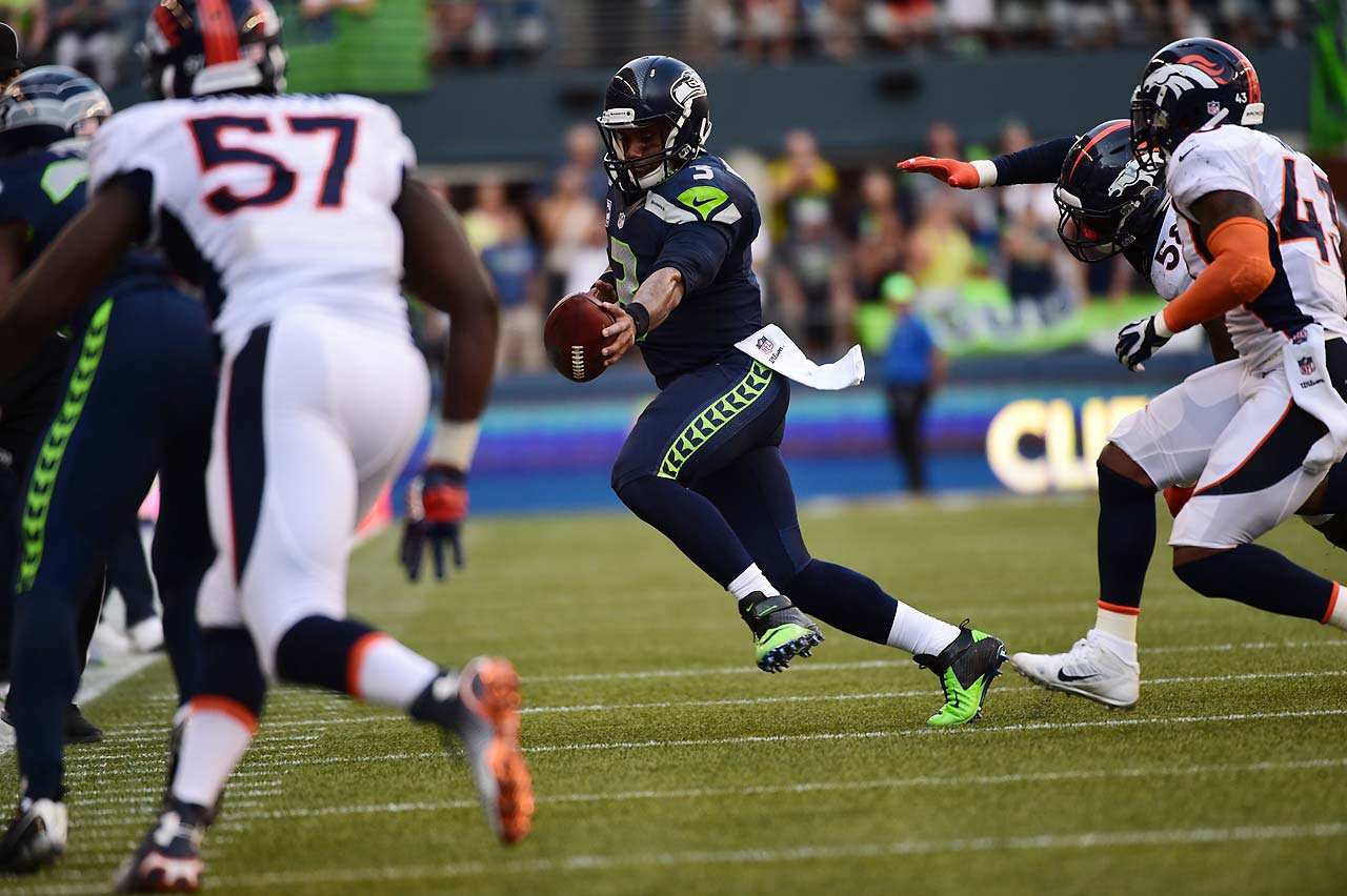Russell Wilson stretches the ball for a first down.