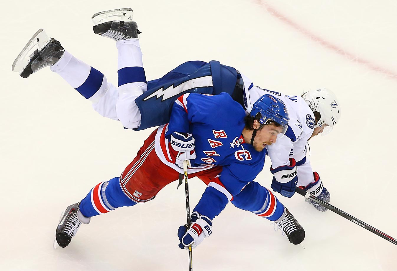 Ryan McDonagh of the New York Rangers upends Victor Hedman of the Tampa Bay Lightning in Game 1 of the Eastern Conference Final.