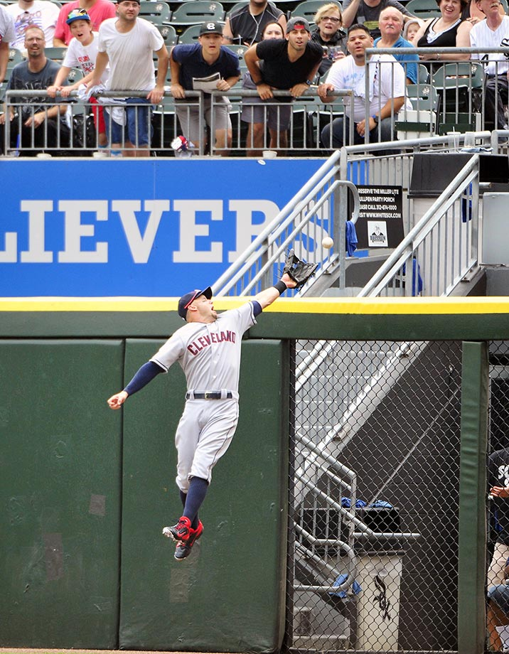 Ryan Raburn fo the Cleveland Indians can't make a catch against the Chicago White Sox.