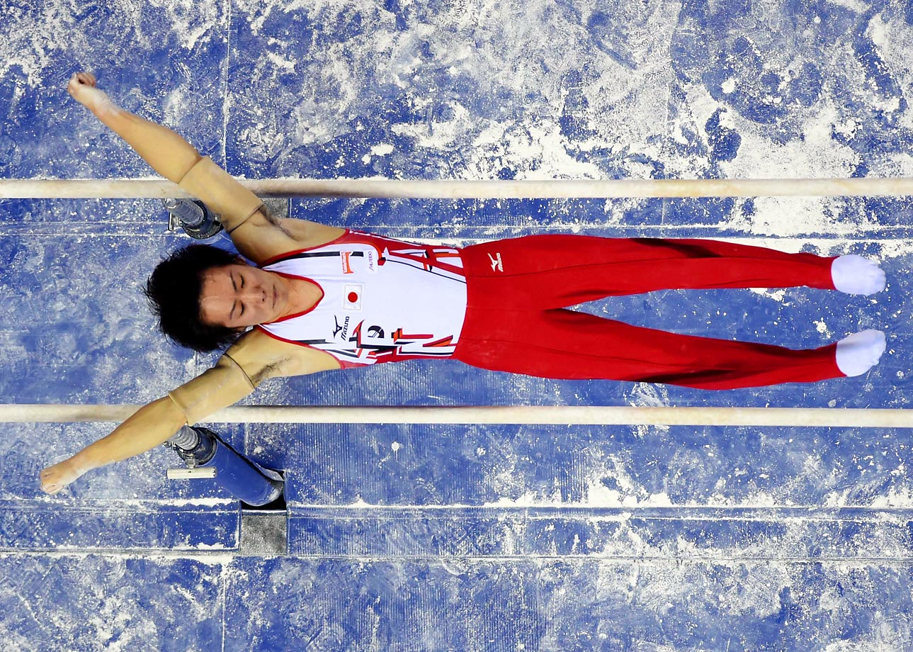 Ryohei Kato of Japan performs on the parallel bars during the team finals of the 45th Gymnastics World Championships in Nanning, China. Japan won the silver medal with 273.269 points.