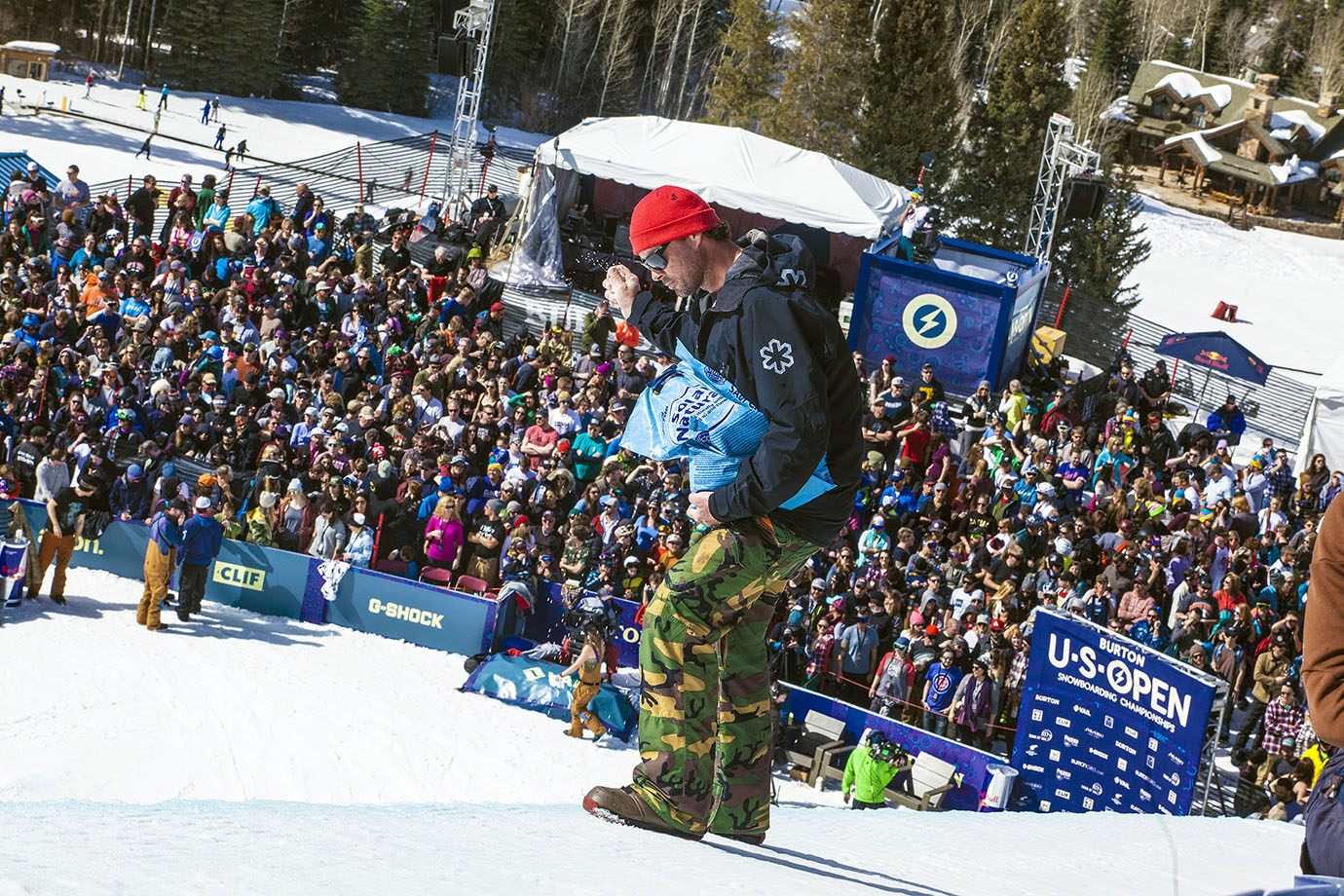 An employee of the Burton U.S. Open preps the pipe for competition, throwing coolant on the side of the walls to battle the unusually high temperatures that have become the trademark of winter this season in Colorado.