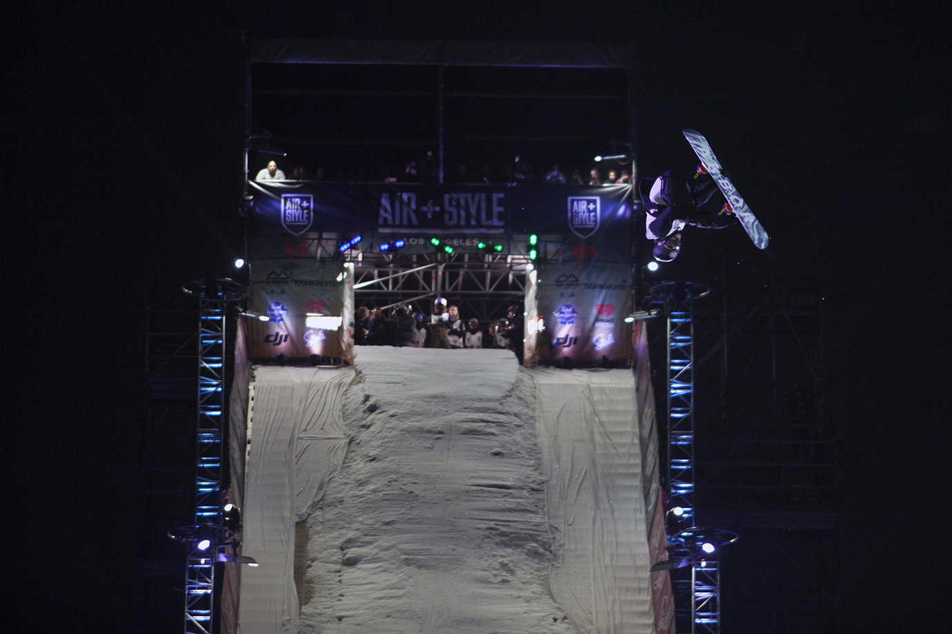 Emil Ulsletten rises into the L.A. night during the final elimination round before the Air+Style Super Final.