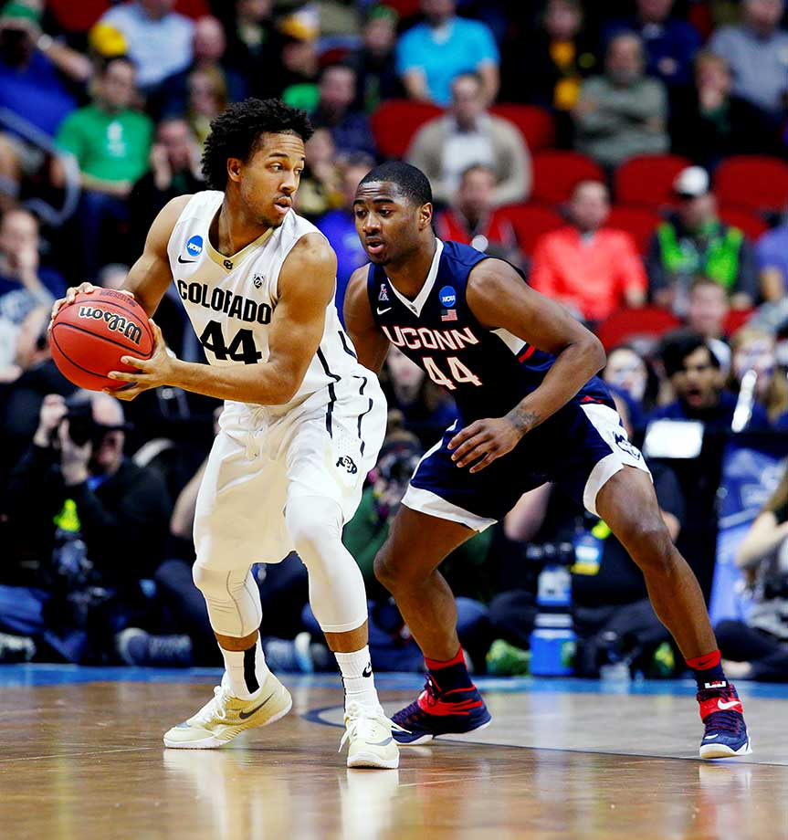 Rodney Purvis of UConn defends against Josh Fortune of Colorado.