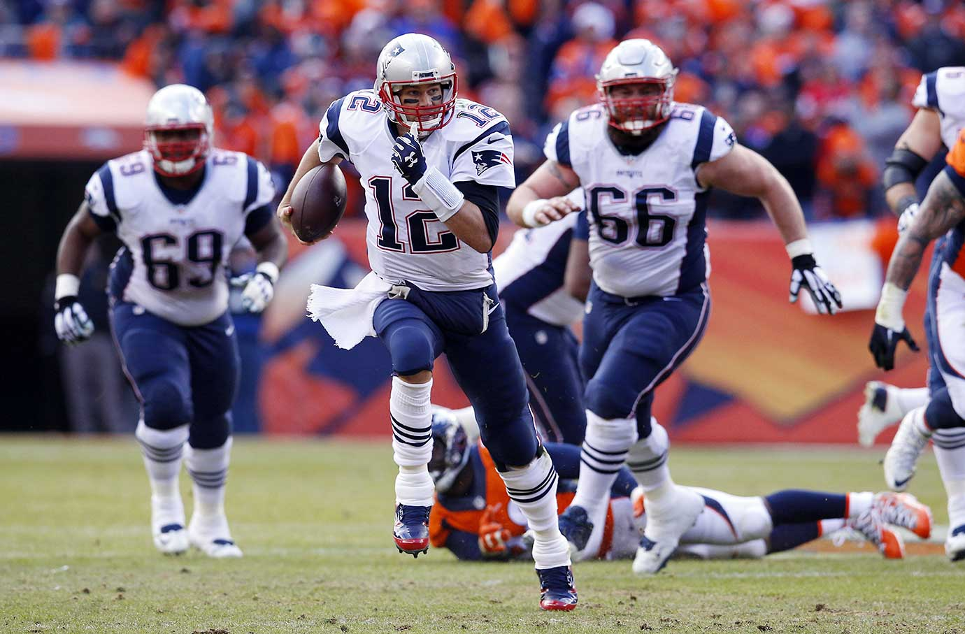 Tom Brady runs for an 11-yard scramble in the second quarter.