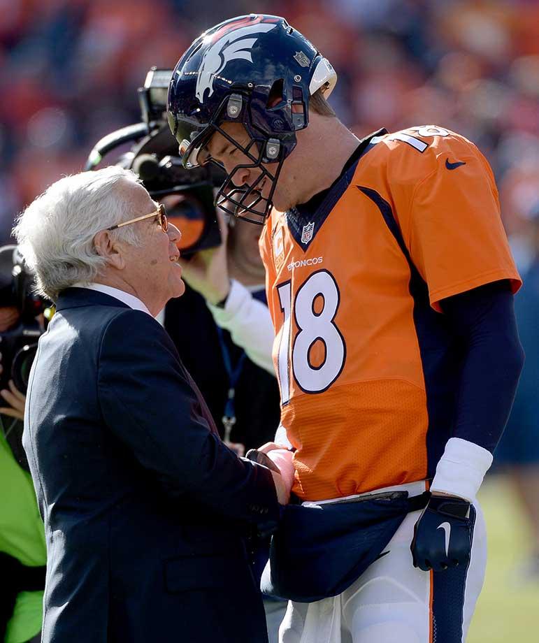 Peyton Manning exchanges greetings with Patriots owner Robert Kraft during warmups.