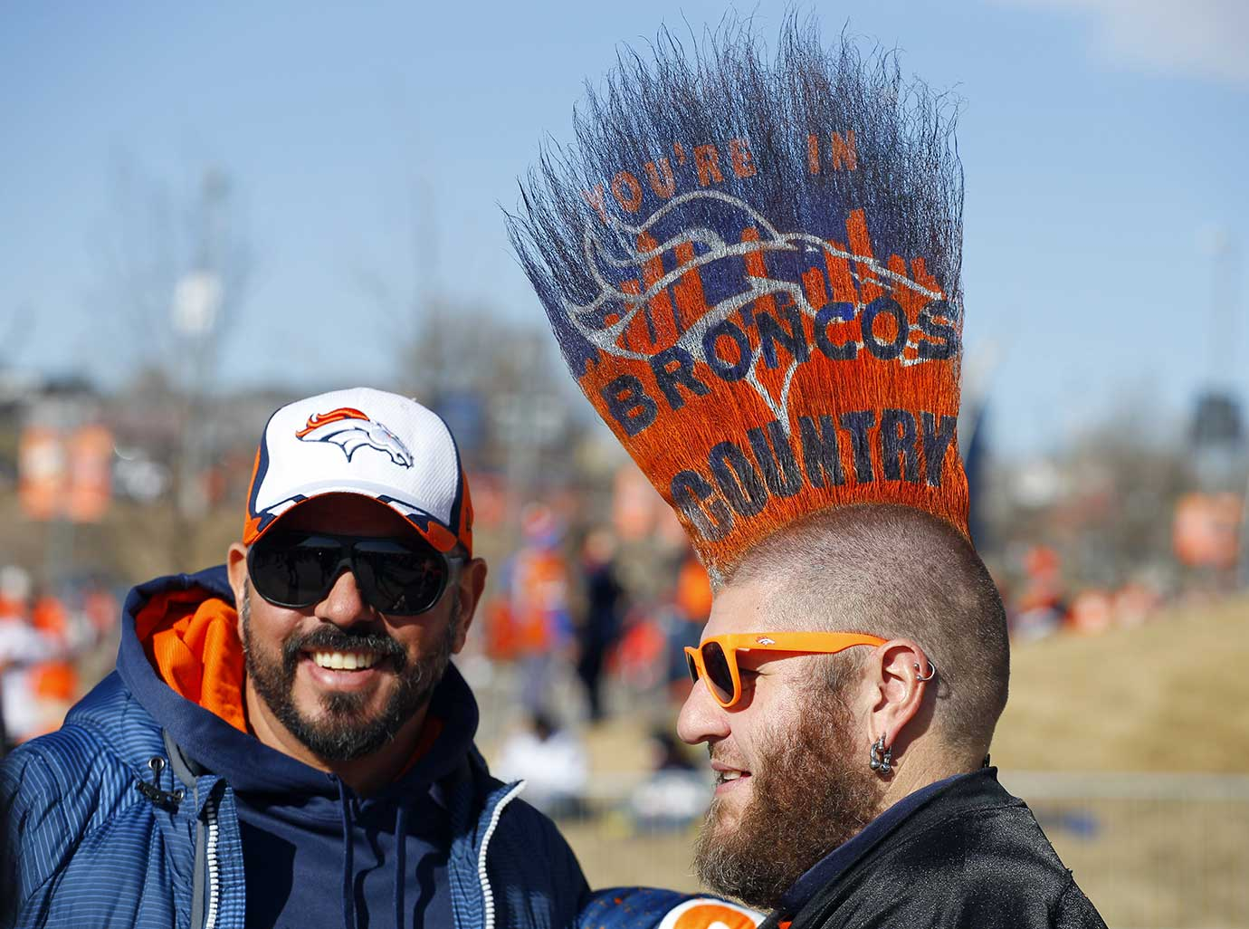 Broncos fan Joshua Pugh has his hair done in a Mohawk.