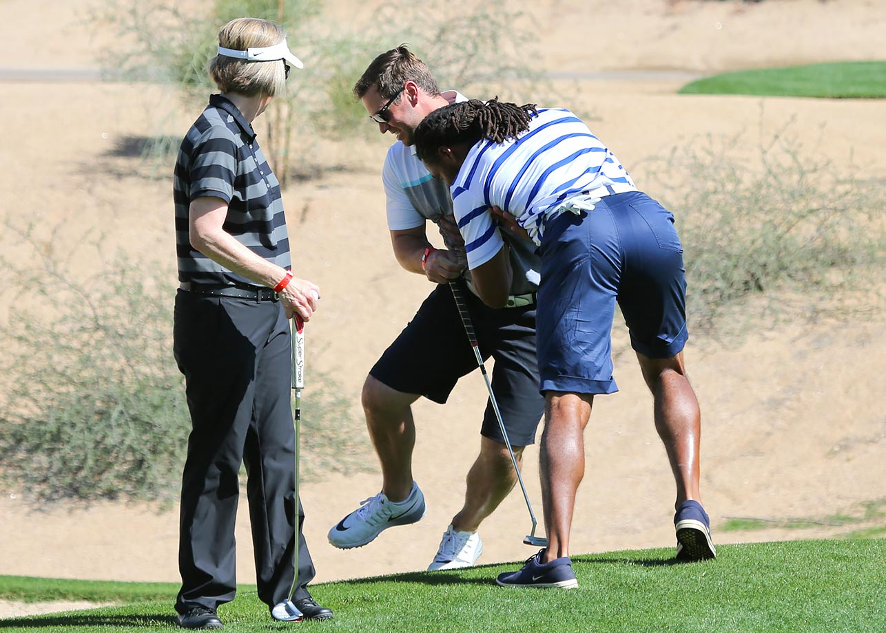 Larry Fitzgerald pushes Drew Stanton into a sand trap at the 3rd Annual Arians Family Foundation Arizona Celebrity Golf Classic in Scottsdale, Ariz.