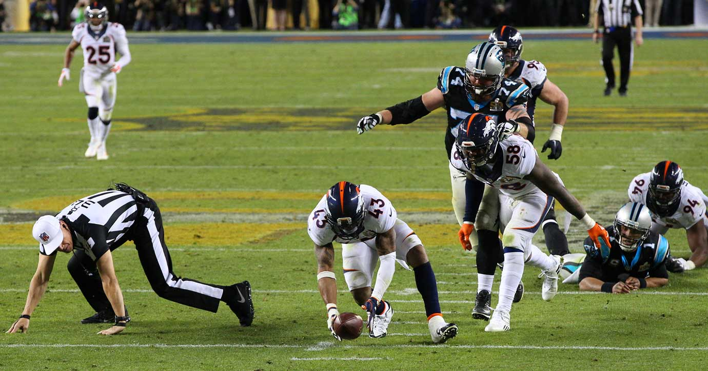 T.J. Ward scoops up a loose ball and takes it to the five to set up Denver's final touchdown.