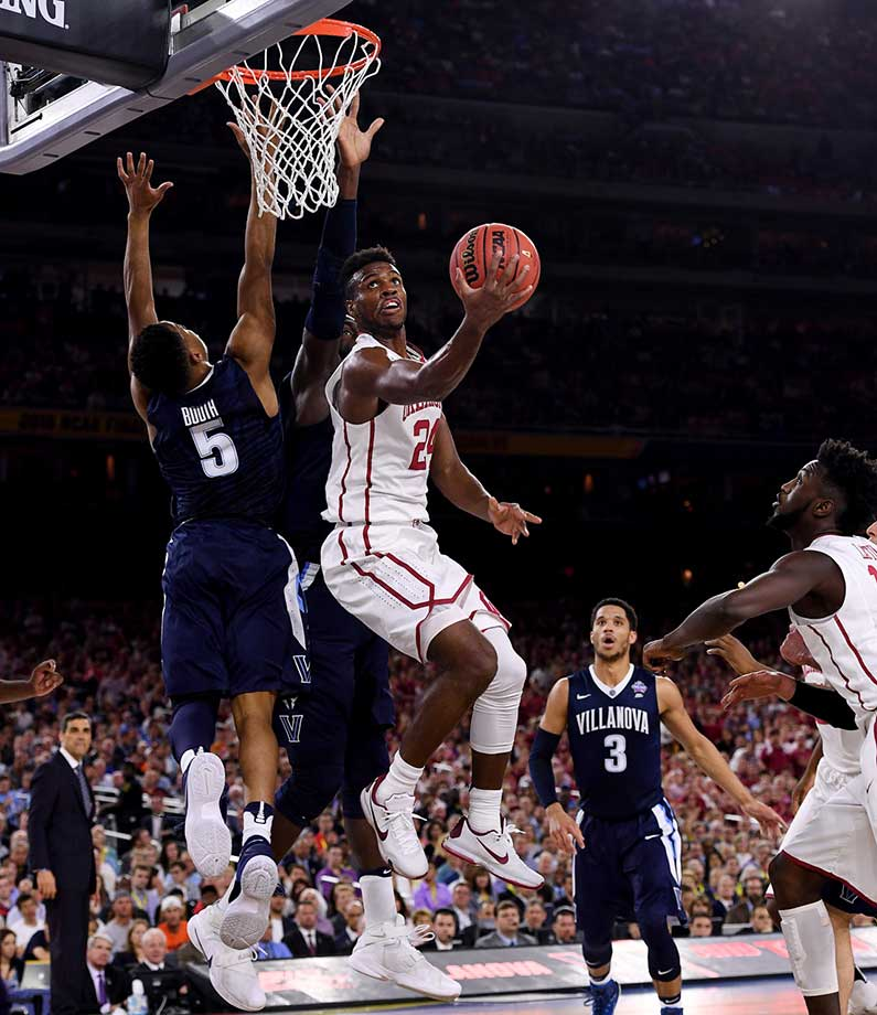 Oklahoma's Buddy Hield scored on this pretty move but was held in check for most of the game, finishing with just nine points as Oklahoma lost 95-51.