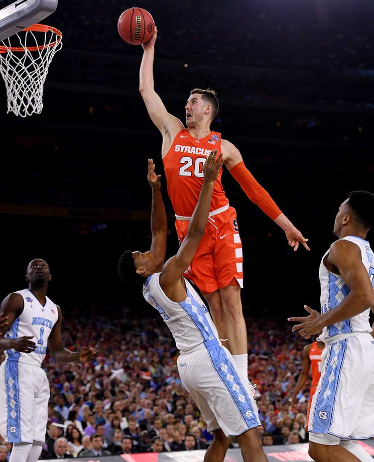 Tyler Lydon of Syracuse went up strong on this dunk attempt but missed it off the back iron.