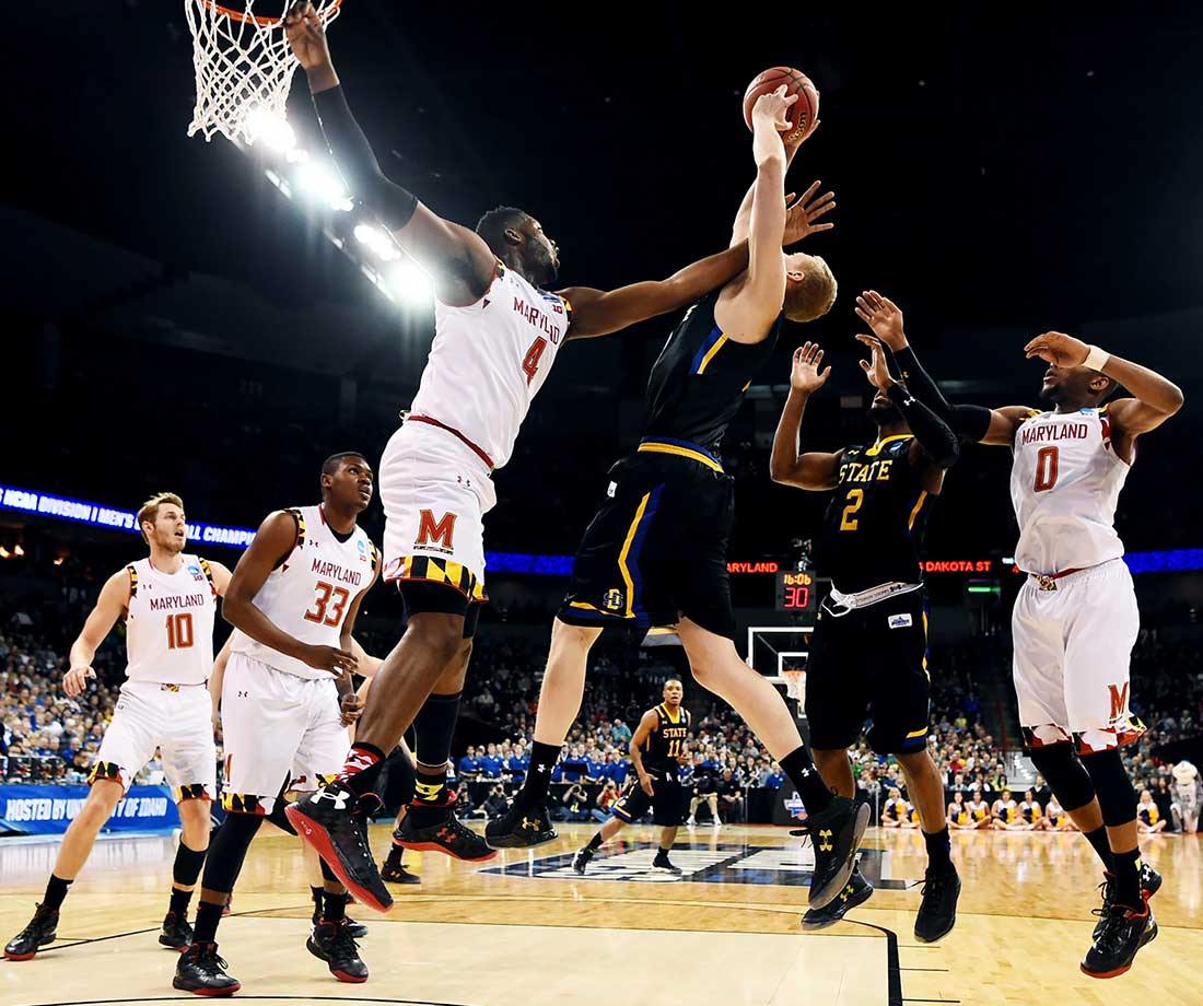 Robert Carter of Maryland defends against Connor Devine of South Dakota State.