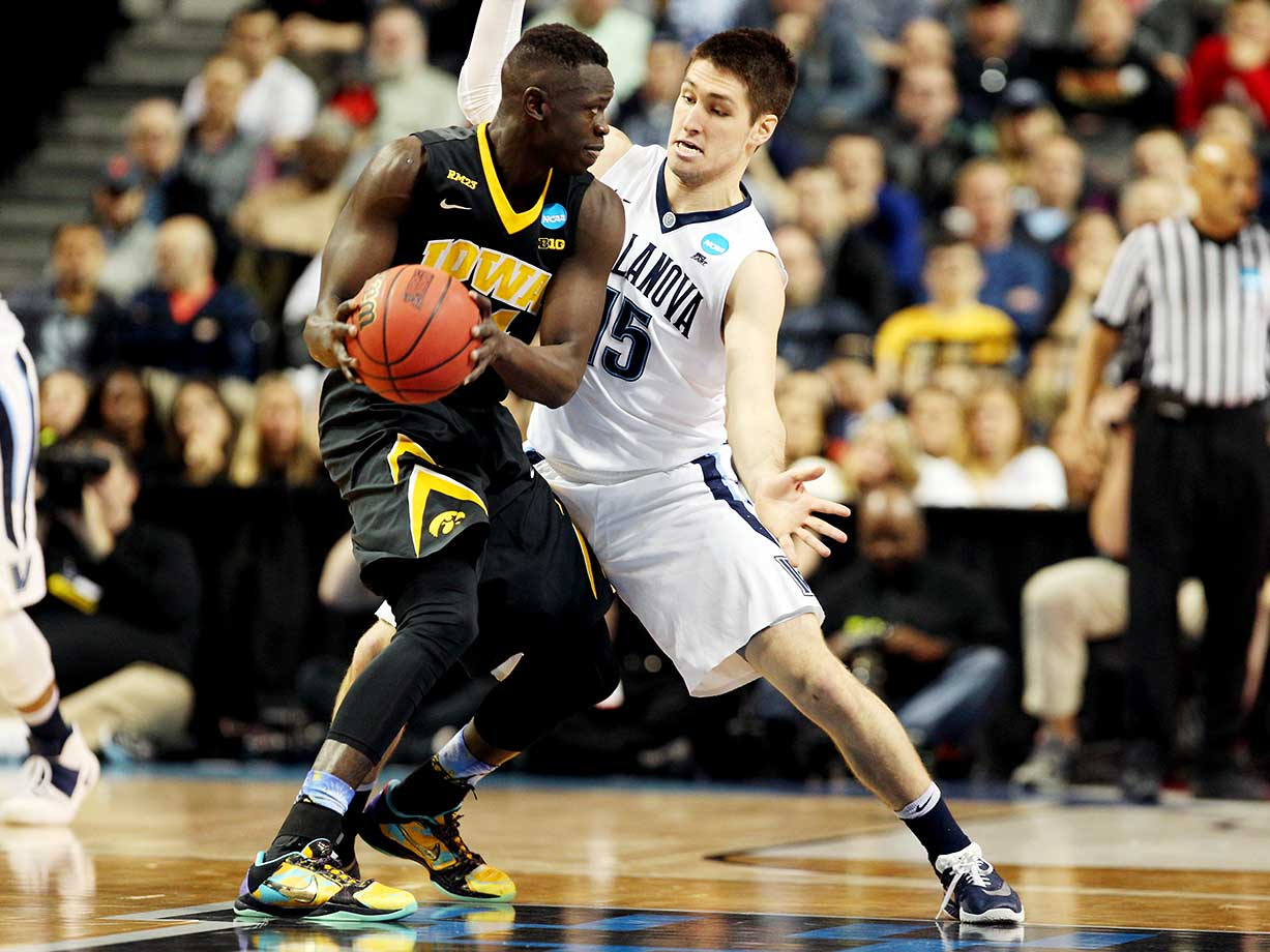 Ryan Arcidiacono of Villanova defends against Iowa.