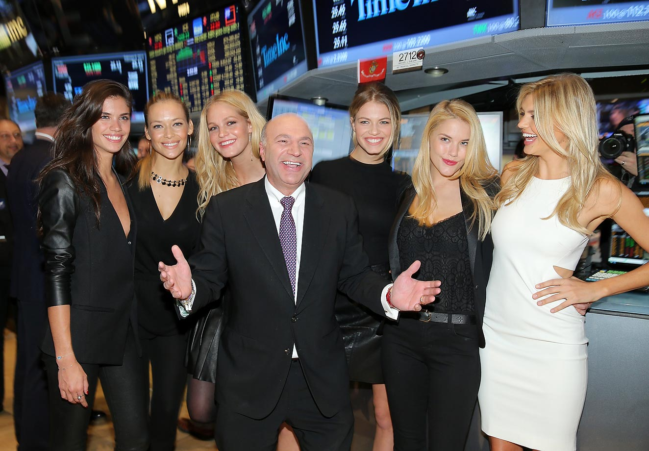 Sports Illustrated swimsuit models Sara Sampaio, Hannah Ferguson, Erin Heatherton, media personality and investor Kevin O' Leary, Hailey Clauson, Ashley Smith and Kelly Rohrbach pose for a photo at the New York Stock Exchange.