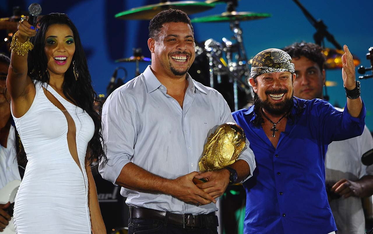Former Brazilian footballer Ronaldo shows off the World Cup during the 2014 FIFA World Cup Fan Fest Kick off Event on June 8, 2014 in Fortaleza, Brazil.