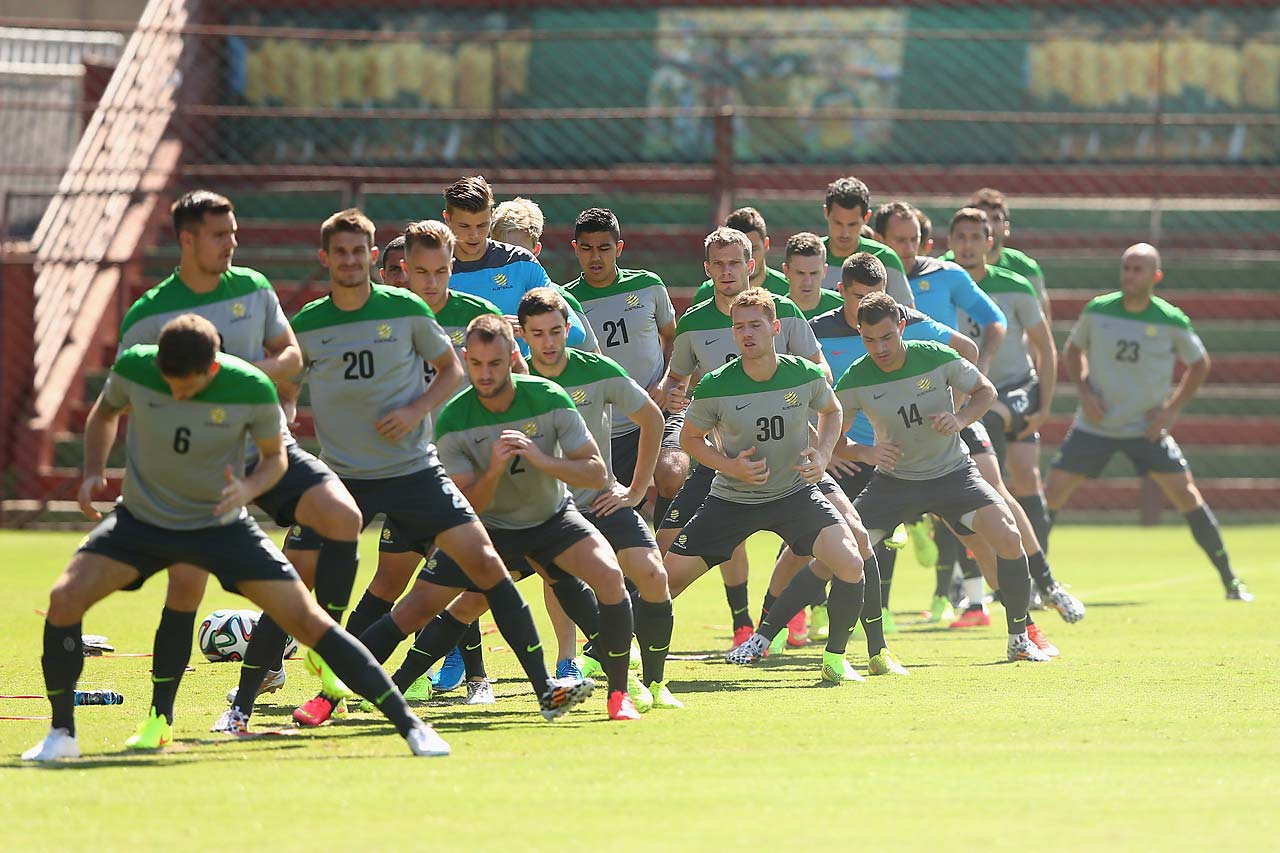 Socceroo players stretch during an Australian Socceroos training session at Arena Unimed Sicoob on June 9 in Vitoria, Brazil.