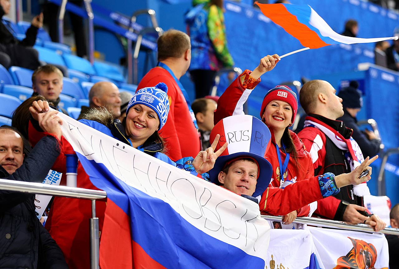 Fans of Team Russia cheer during their women's hockey team's game against Germany.