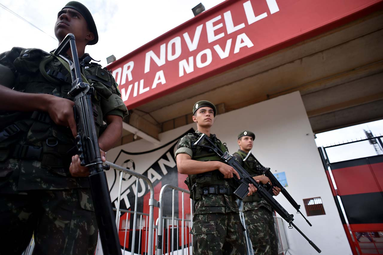 Brazilian military troops stand guard before the training session of Russia's national football team at Estadio Novelli Jr in Itu, close to Sao Paolo, on June 10.