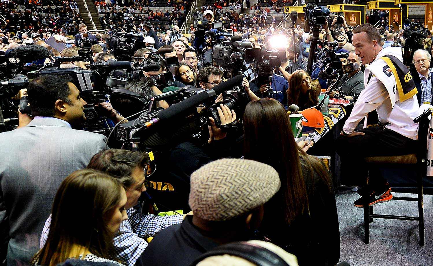 Peyton Manning answers questions from the media assembled during the Super Bowl Opening Night at SAP Center in San Jose, Calif.