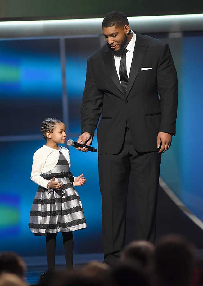Leah and Devon Still speak onstage during the 5th Annual NFL Honors program.