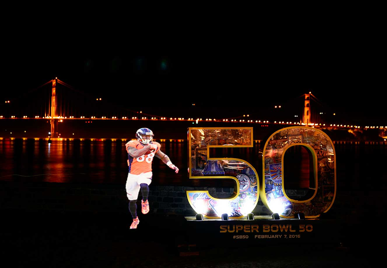 A still photo of Demaryius Thomas painted with light using a Pixelstick during a 13-second long exposure.  Golden Gate Bridge in background.