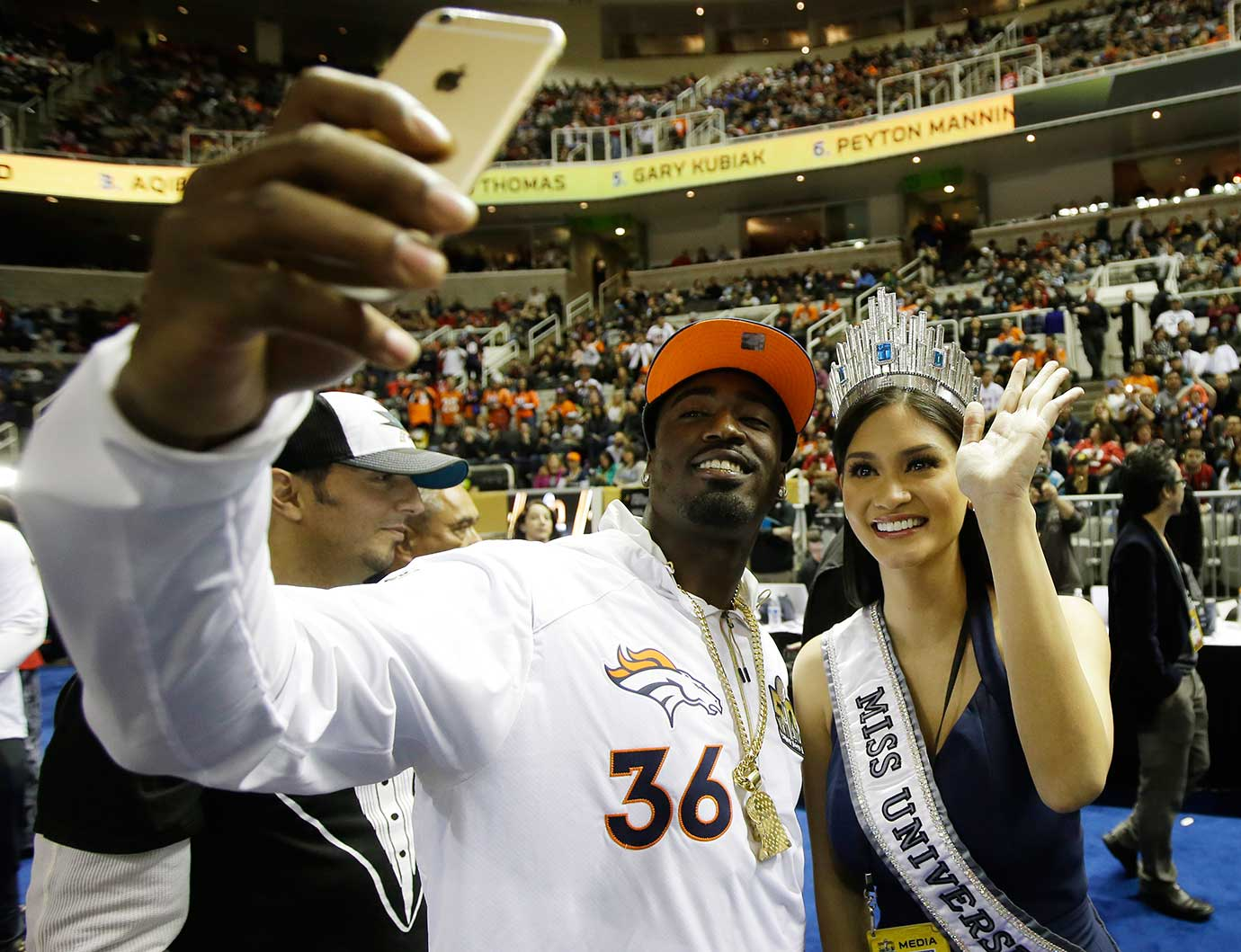 Miss Universe Pia Alonzo Wurtzbach poses with Denver Broncos cornerback Kayvon Webster during Opening Night for Super Bowl 50 in San Jose, Calif.