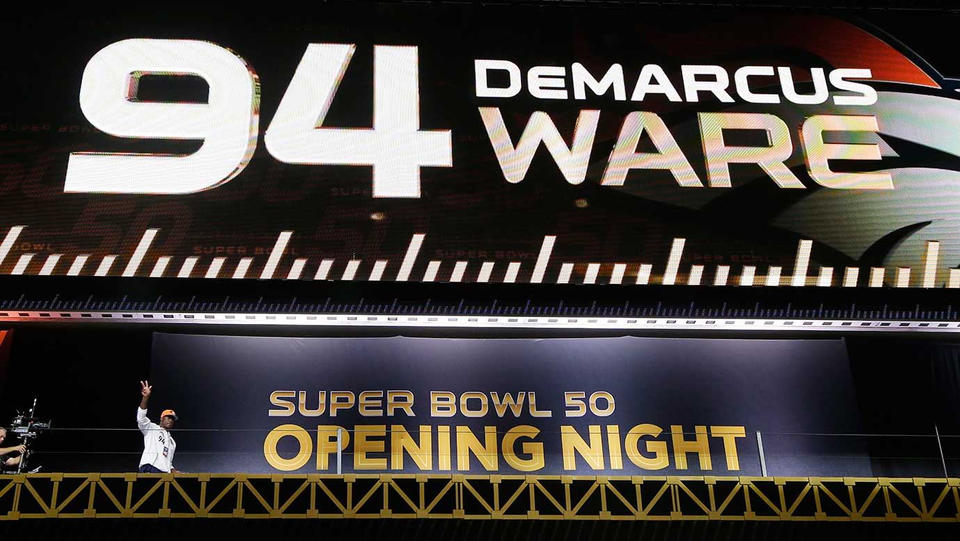 Denver Broncos outside linebacker DeMarcus Ware waves as he enters the SAP Center during Opening Night for the NFL Super Bowl 50. (AP Photo/Charlie Riedel)