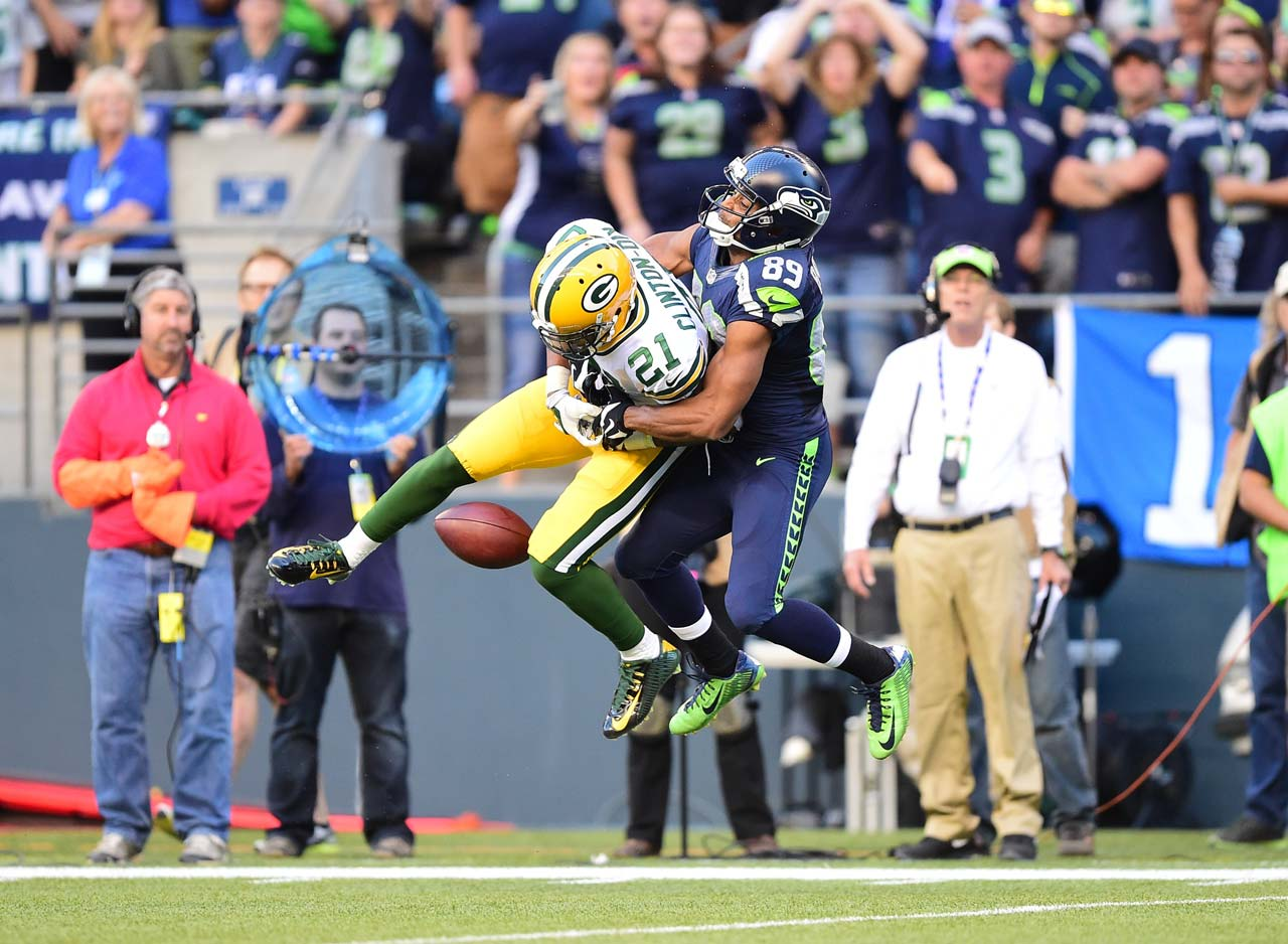 Seattle wideout Doug Baldwin turned into a defender to keep Ha Ha Clinton-Dix from intercepting this pass during the Seahawks victory over Green Bay.