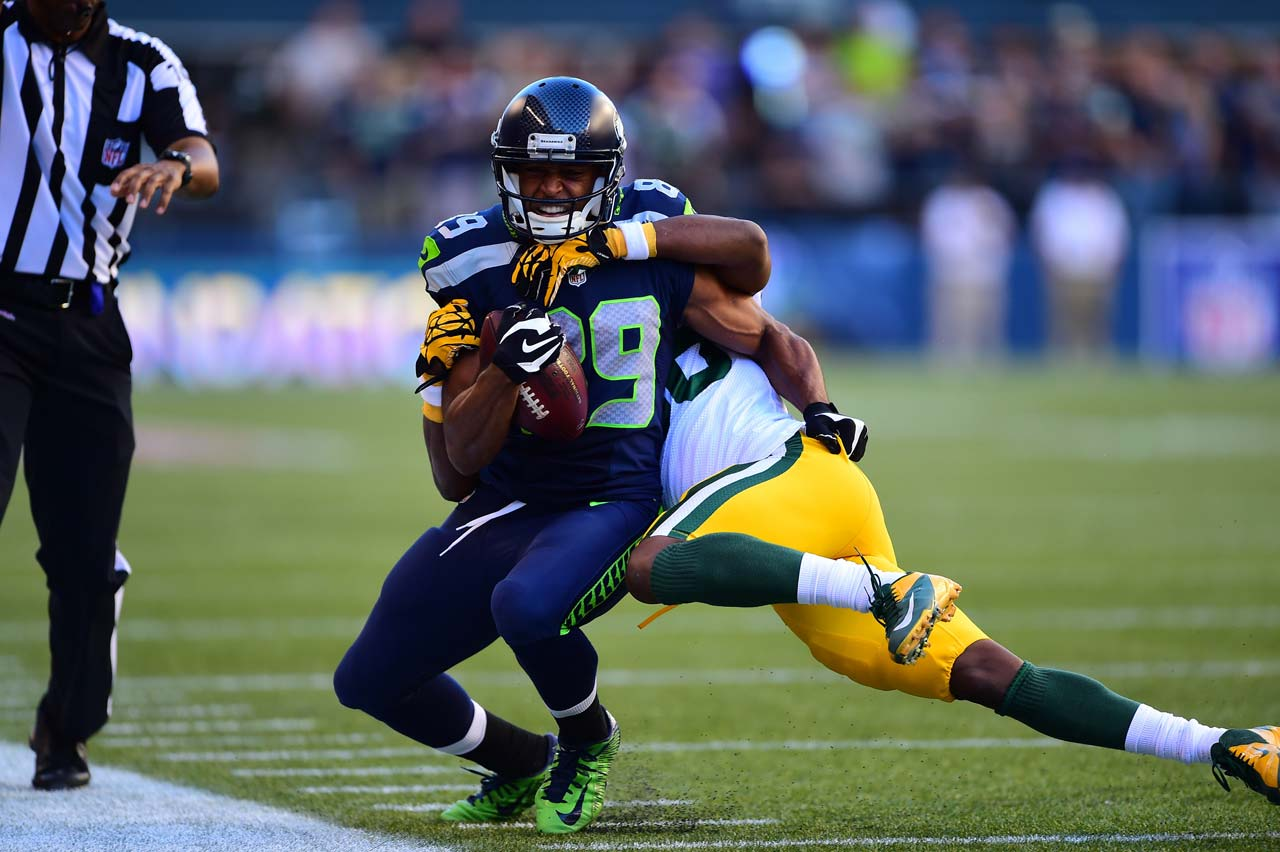 Doug Baldwin gets taken down after making one of his three receptions (14 yards total).